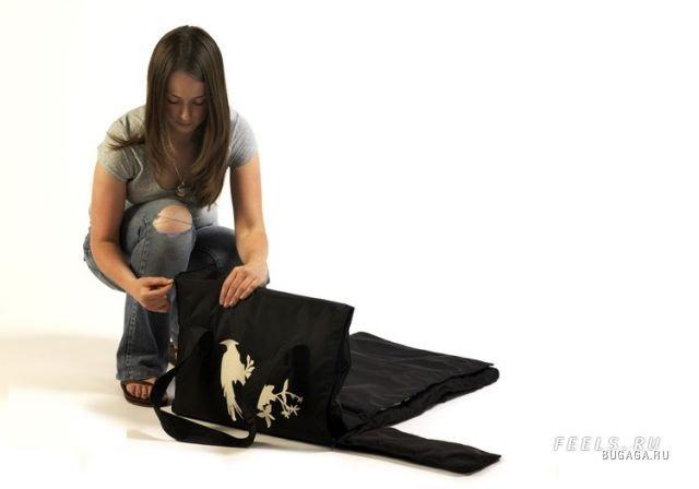 Лёгкими движениями сумка превращается.