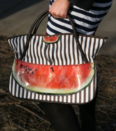 An unusual zebra-colored bag with two pieces of water-melon pockets.