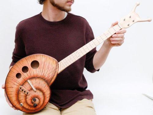Укулеле - гитара-улитка