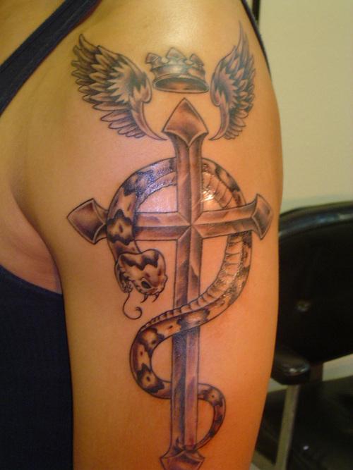 Тату крест со змеёй значение