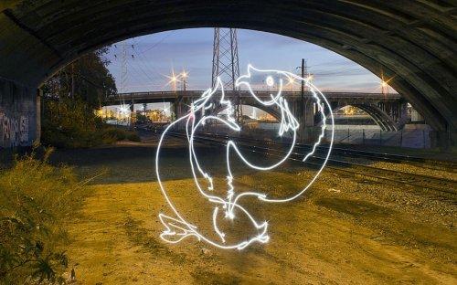 Знаки зодиака, нарисованные светом