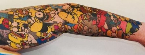 Мировой рекорд по количеству татуировок с мультяшным персонажем (7 фото)