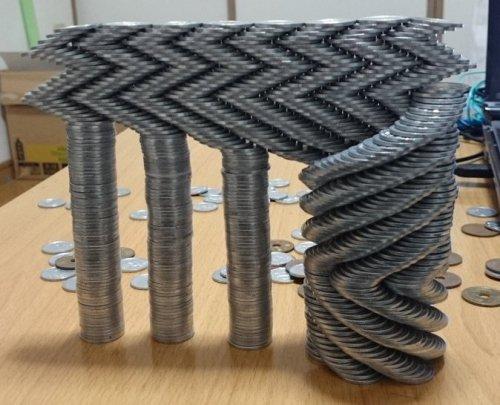 Невероятные конструкции из монет, бросающие вызов гравитации (14 фото)