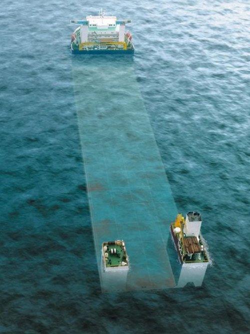 Грузовое судно, поражающее воображение своими размерами и возможностями (11 фото)