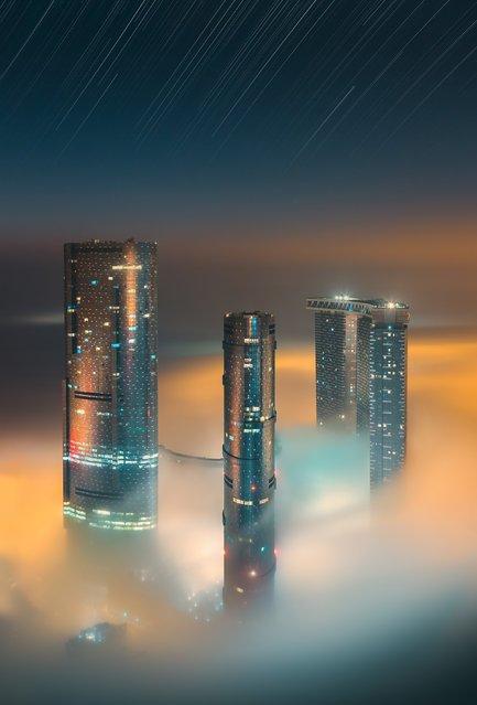 Живописный Абу-Даби в облаках (12 фото)