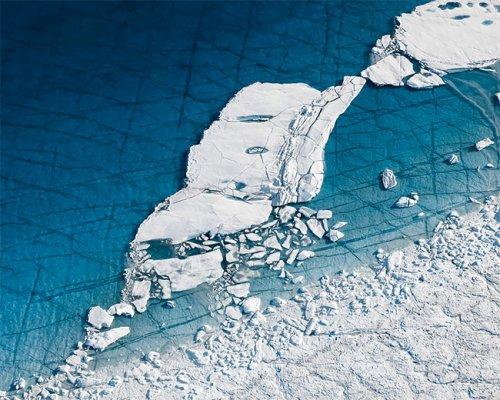 Тающая Гренландия в аэрофотоснимках Тома Хегена как напоминание о проблеме глобального потепления (19 фото)