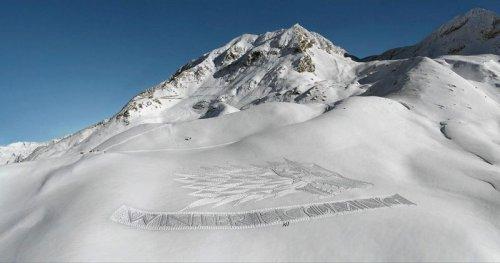 """Огромный рисунок лютоволка на снегу, приуроченный к показу """"Игры престолов"""" (4 фото + видео)"""