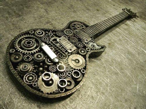 Волгоградский мастер создаёт из металлолома модели автомобилей, пистолетов и другие скульптуры (26 фото)