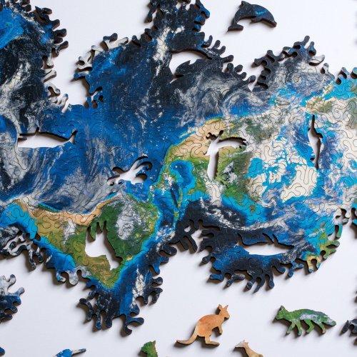 """Дизайн-студия создала безграничный пазл """"Земля"""" с элементами в форме животных (6 фото)"""
