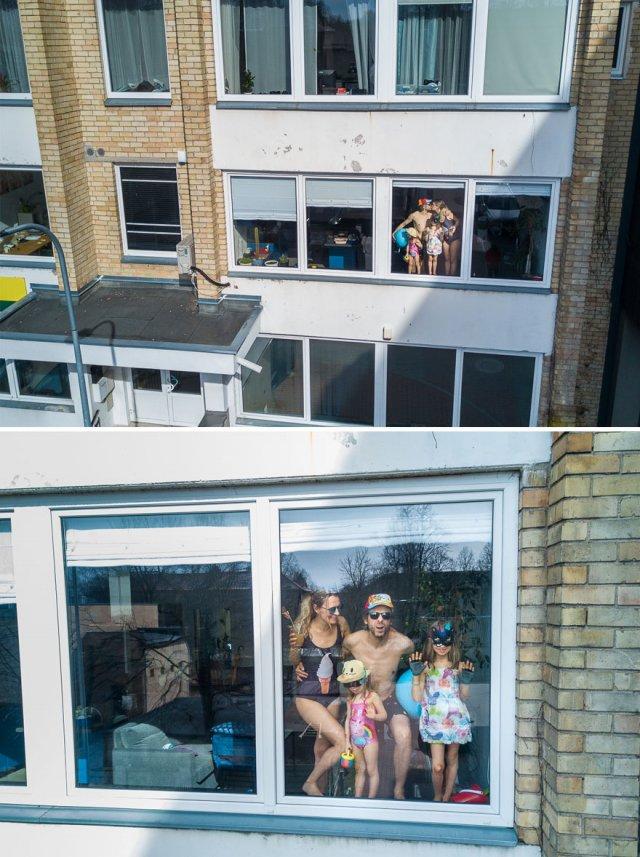 Литовский фотограф с помощью дрона фотографирует людей, сидящих дома на карантине